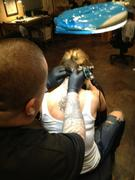 Mena Suvari Getting a Tattoo at Mr. Cartoon's Skid Row Tattoo Shop in Los Angeles on February 6, 2012